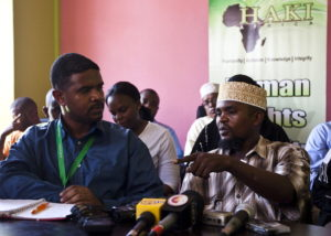 """Said Mohammed (R), who was with outspoken radical cleric Abubakar Shariff a.k.a Makaburi at the time of his death, talks during a press conference called by the HAKI Africa human rights group condemning the shooting, in the coastal city of Mombasa on April 2, 2014. The assasinated cleric, Abubaker Shariff Ahmed, was a vocal supporter of Osama bin Laden, and was on UN sanctions lists accused of being a """"leading facilitator and recruiter of young Kenyan Muslims for violent militant activity in Somalia"""", and of having """"strong ties"""" with the leaders of neighbouring Somalia's Shebab. AFP PHOTO/IVAN LIEMAN        (Photo credit should read Ivan Lieman/AFP/Getty Images)"""