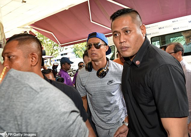 Cristiano Ronaldo arrives at Singapore hospital to visit Valencia owner Peter Lim's daughter after she gave birth.