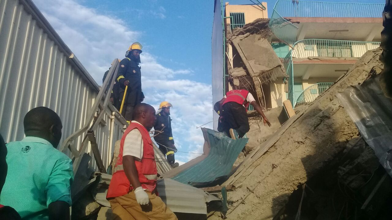 A building marked for demolition collapses in Nakuru