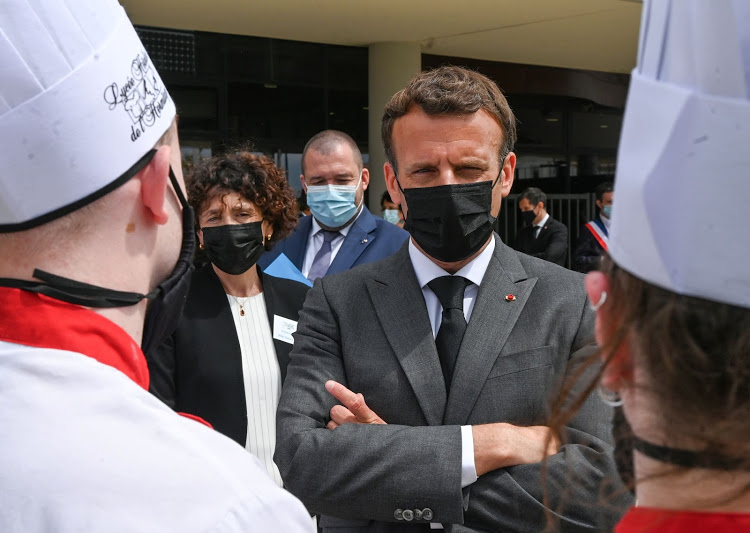A villager slaps French President Macron in face during walkabout